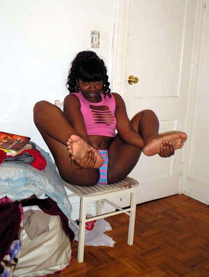 Naughty black babes posing at home