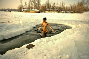 Nudist girl swimming in river in the..